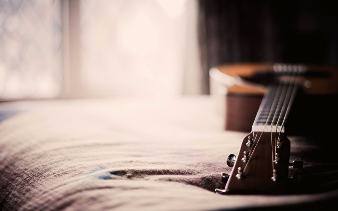 Guitar on Bed Wallpapers